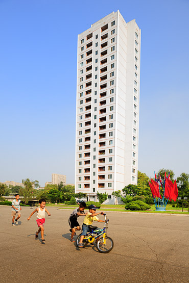 kids playing in the street in Pyongyang